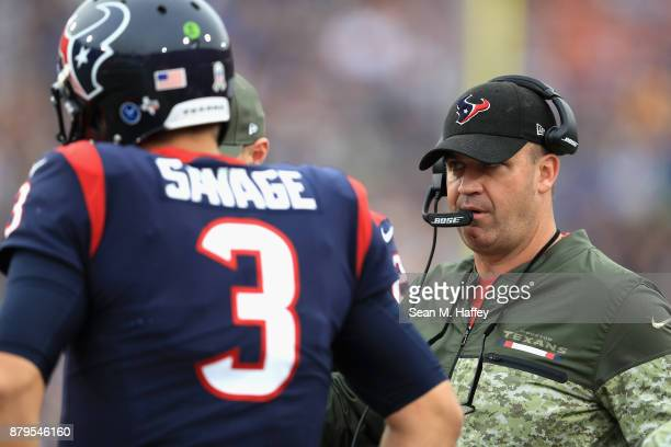Head coach Bill O'Brien talks with Tom Savage of the Houston Texans during the first half of game against the Los Angeles Rams at Los Angeles...