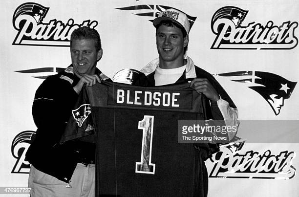 Head coach Bill Parcells of the New England Patriots presents overall pick in the 1993 NFL Draft Drew Bledsoe with a Patriots jersey after the...
