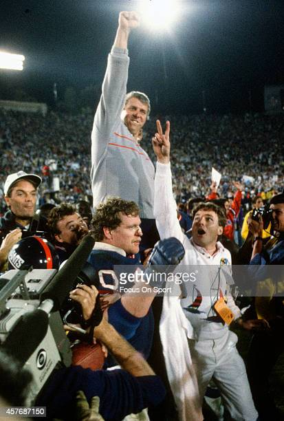 Head Coach Bill Parcells of the New York Giants gets carried off the field after they defeated the Denver Broncos in Super Bowl XXI on January 26...