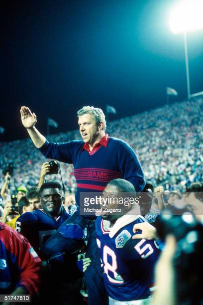 Head coach Bill Parcells of the New York Giants is carried off the sideline by Carl Banks Lawrence Taylor and others after a 20 to 19 win over the...