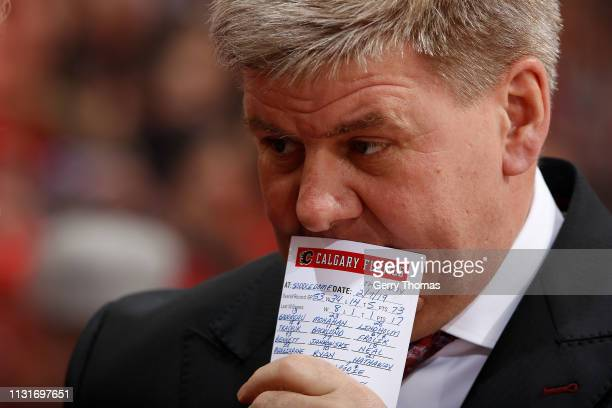 Head coach Bill Peters of the Calgary Flames behind the bench against the San Jose Sharks at Scotiabank Saddledome on February 7 2019 in Calgary...