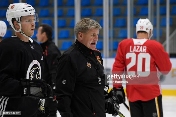 Head coach Bill Peters of the Calgary Flames gives instructions during practice at the ORG AZ Rink on September 17 2018 in Beijing China