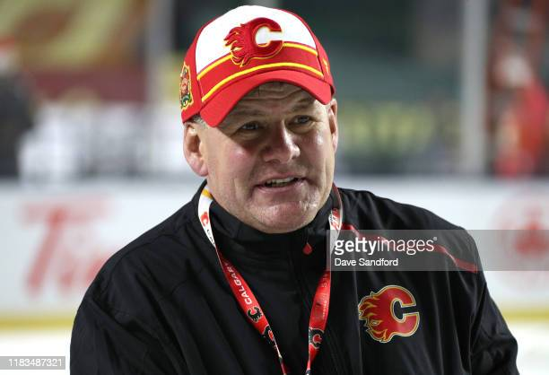 Head coach Bill Peters of the Calgary Flames looks on during practice prior to the 2019 Tim Hortons NHL Heritage Classic at Mosaic Stadium on October...