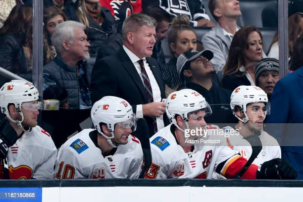 Head coach Bill Peters of the Calgary Flames looks on from the bench during the first period of the game against the Los Angeles Kings at STAPLES...