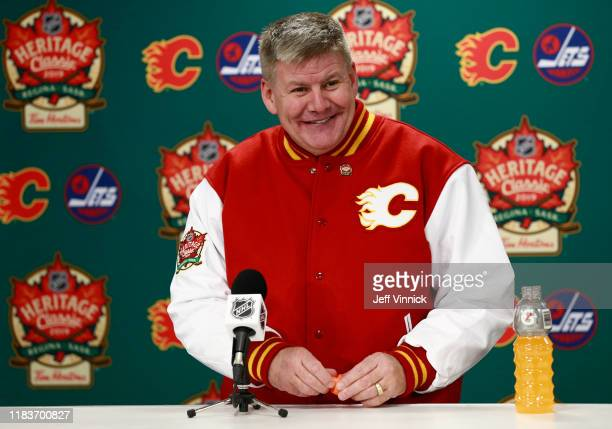 Head coach Bill Peters of the Calgary Flames speaks at the post game press conference after the 2019 Tim Hortons NHL Heritage Classic between the...