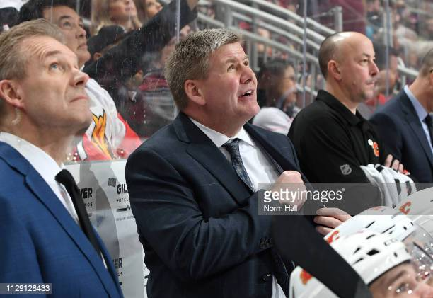 Head coach Bill Peters of the Calgary Flames watches the video board during third period action against the Arizona Coyotes at Gila River Arena on...