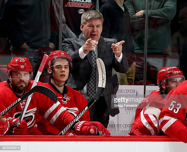 Head coach Bill Peters of the Carolina Hurricanes directs players from the bench area during an NHL game against the Montreal Canadiens on November...