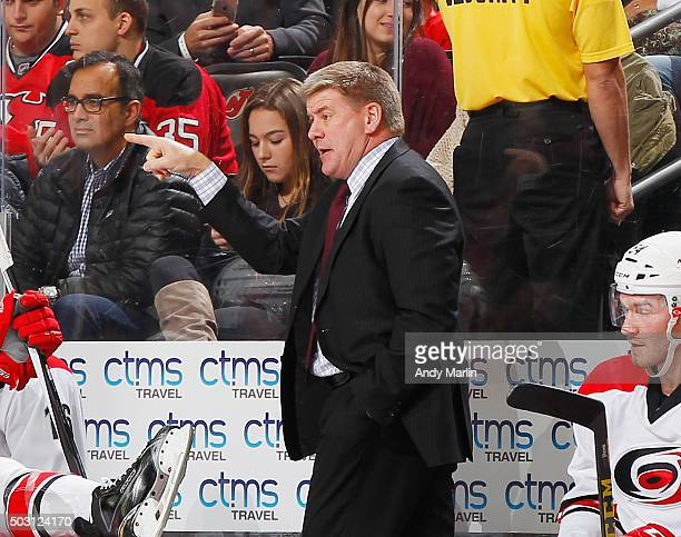 Head coach Bill Peters of the Carolina Hurricanes gives instructions against the New Jersey Devils during the game at the Prudential Center on...