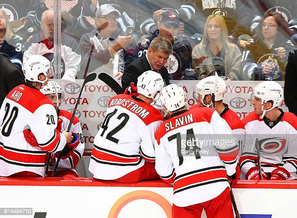 Head Coach Bill Peters of the Carolina Hurricanes lays out a strategy for his players during a second period stoppage in play against the Winnipeg...