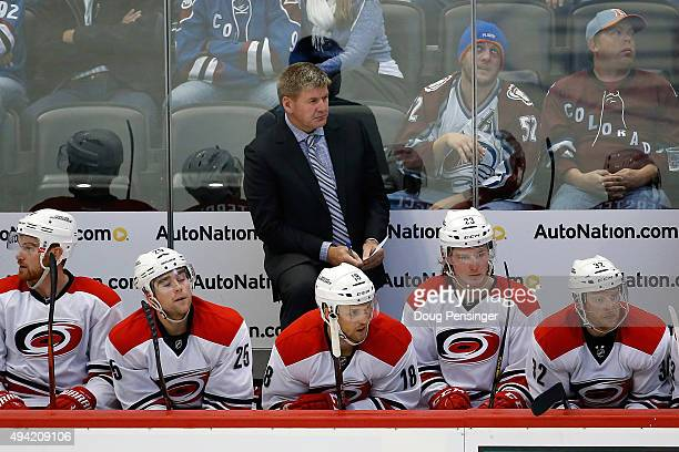 Head coach Bill Peters of the Carolina Hurricanes leads his team against the Colorado Avalanche at Pepsi Center on October 21 2015 in Denver Colorado...