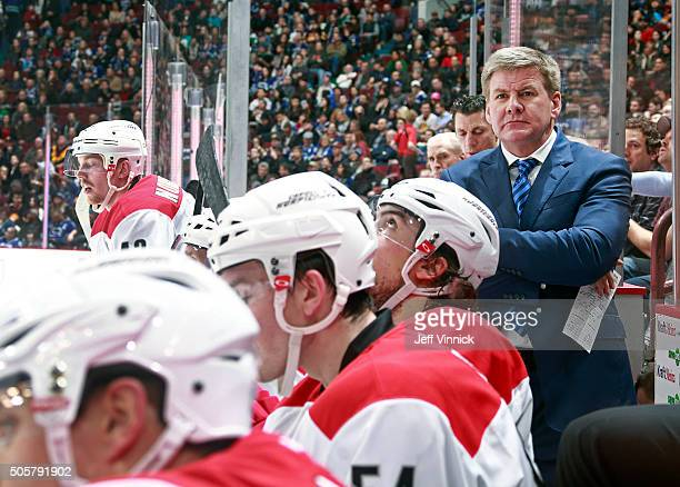 Head coach Bill Peters of the Carolina Hurricanes looks on from the bench during their NHL game against the Vancouver Canucks at Rogers Arena January...