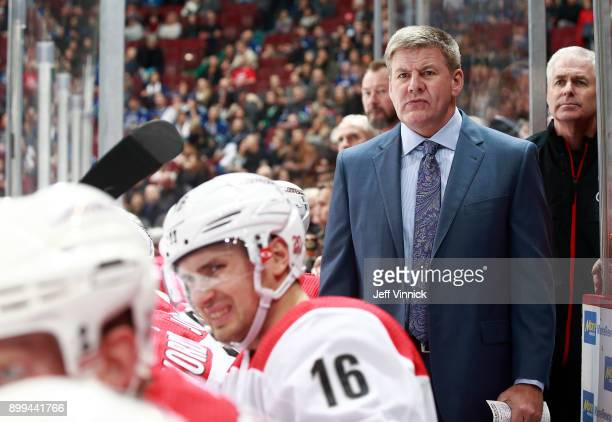 Head coach Bill Peters of the Carolina Hurricanes looks on from the bench during their NHL game against the Vancouver Canucks at Rogers Arena...