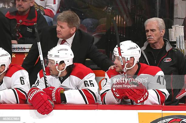 Head coach Bill Peters of the Carolina Hurricanes pats Michal Jordan on the shoulder after the latter scored his first career NHL goal in a game...
