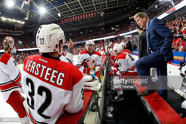 Head coach Bill Peters of the Carolina Hurricanes speaks to his players during an NHL game against the Calgary Flames at Scotiabank Saddledome on...