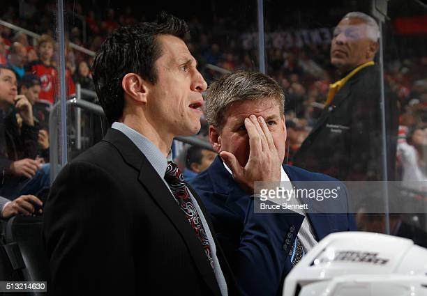 Head coach Bill Peters of the Carolina Hurricanes speaks with assistant coach Rob Brind'Amour during the first period against the New Jersey Devils...