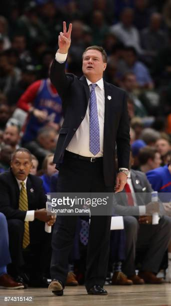 Head coach Bill Self of the Kansas Jayhawks calls a play against the Kentucky Wildcats during the State Farm Champions Classic at the United Center...