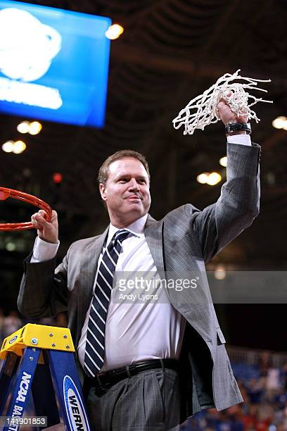 Head coach Bill Self of the Kansas Jayhawks celebrates after cutting down a piece of the net after winning 80-67 against the North Carolina Tar Heels...