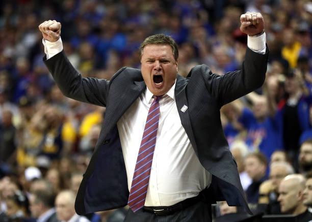 Head coach Bill Self of the Kansas Jayhawks celebrates as the Jayhawks defeat the West Virginia Mountaineers 81-70 to win the Big 12 Basketball...