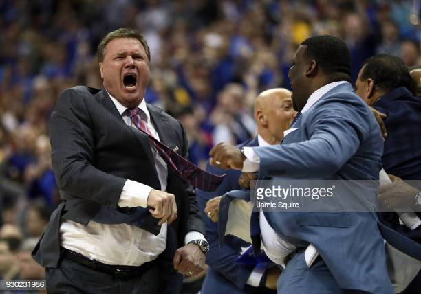 Head coach Bill Self of the Kansas Jayhawks celebrates with assistant coaches as the Jayhawks defeat the West Virginia Mountaineers 8170 to win the...
