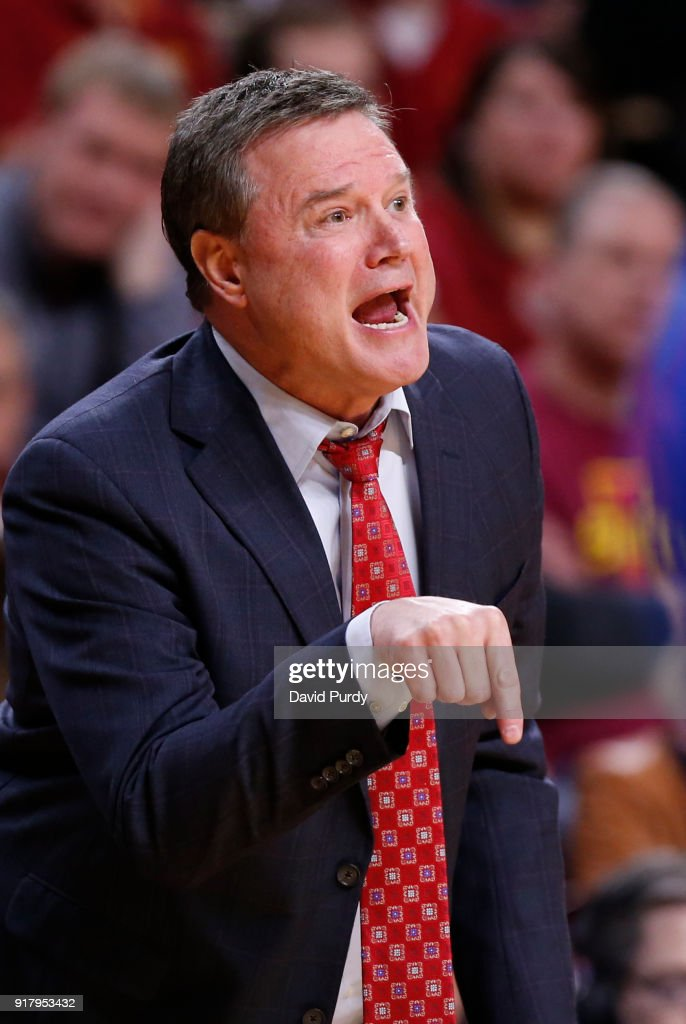 Head coach Bill Self of the Kansas Jayhawks coaches from the bench in the first half of play against the Iowa State Cyclones at Hilton Coliseum on February 13, 2018 in Ames, Iowa.