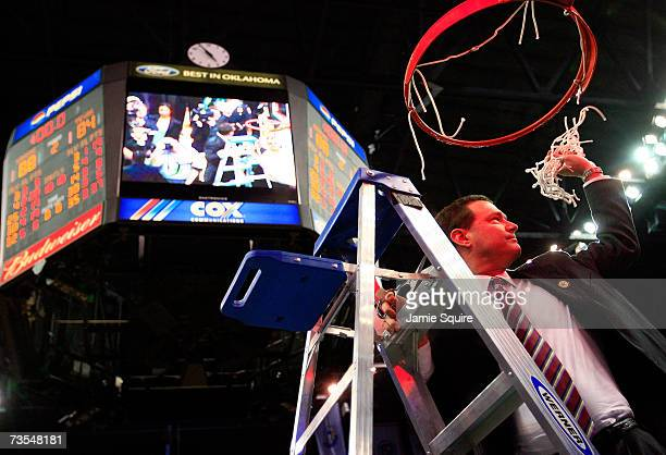 Head coach Bill Self of the Kansas Jayhawks cuts down the net following the Jayhawks victory in the finals of the Phillips 66 Big 12 Men's Basketball...
