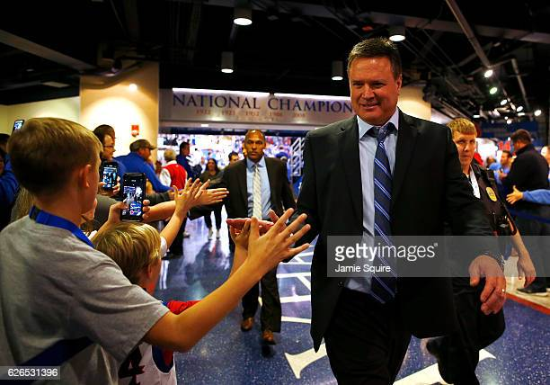Head coach Bill Self of the Kansas Jayhawks highfives kids as he walks off the court following the game against the Long Beach State 49ers at Allen...