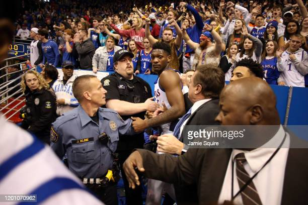 Head coach Bill Self of the Kansas Jayhawks holds back Silvio De Sousa of the Kansas Jayhawks during a brawl as the game against the Kansas State...