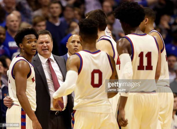 Head coach Bill Self of the Kansas Jayhawks huddles with players during the game against the West Virginia Mountaineers at Allen Fieldhouse on...