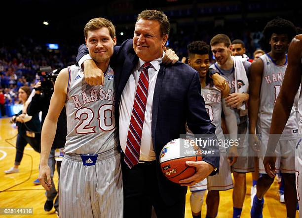 Head coach Bill Self of the Kansas Jayhawks hugs son Tyler Self after ebing honored for his 600th win following the game against the UMKC Kangaroos...