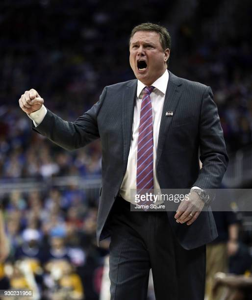 Head coach Bill Self of the Kansas Jayhawks reacts from the bench during the Big 12 Basketball Tournament Championship game against the West Virginia...