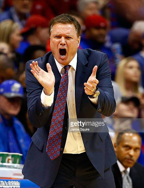 Head coach Bill Self of the Kansas Jayhawks reacts on the bench during the game against the Oklahoma State Cowboys at Allen Fieldhouse on February 15...
