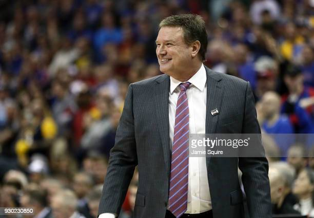 Head coach Bill Self of the Kansas Jayhawks smiles as the Jayhawks defeat the West Virginia Mountaineers 8170 to win the Big 12 Basketball Tournament...
