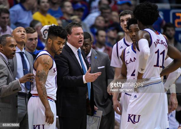 head coach Bill Self of the Kansas Jayhawks talks to his team during a timeout as they trail Iowa State with less than a minute left in overtime on...