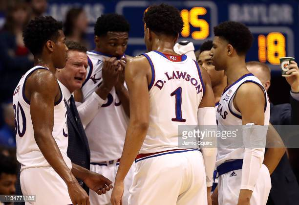 Head coach Bill Self of the Kansas Jayhawks talks with players during a timeout in the game against the Baylor Bears at Allen Fieldhouse on March 09...