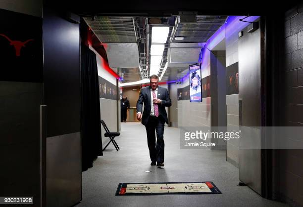 Head coach Bill Self of the Kansas Jayhawks walks out of the locker room toward the court prior to the Big 12 Basketball Tournament Championship game...
