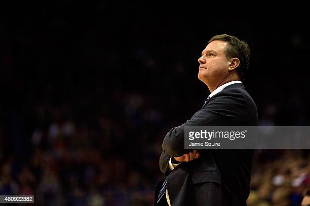 Head coach Bill Self of the Kansas Jayhawks watches from the bench during the game against the Kent State Golden Flashes at Allen Fieldhouse on...