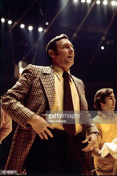 Head Coach Bill Sharman of the Los Angeles Lakers watches his team from the sideline during an NBA game at the Forum circa 1972 in Los Angeles...
