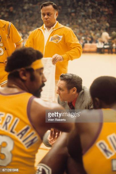 Head Coach Bill Sharman of the West goes over the game play against the East during the 1972 NBA AllStar Game on January 18 1972 at The Forum in...