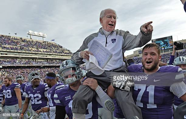 Head coach Bill Snyder of the Kansas State Wildcats gets carried off the field, after winning his 200th career game against the Kansas Jayhawks on...