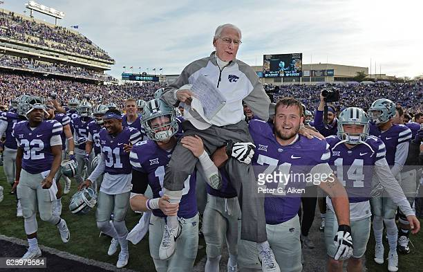 Head coach Bill Snyder of the Kansas State Wildcats gets carried off the field after winning his 200th career game against the Kansas Jayhawks on...