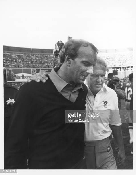 Head coach Bill Walsh of the San Francisco 49ers consoles head coach Sam Wyche of the Cincinnati Bengals following the game at Candlestick Park on...
