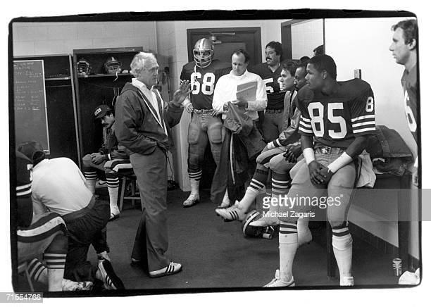 Head coach Bill Walsh of the San Francisco 49ers gives a pregame speech in the locker room before the game against the New Orleans Saints at...
