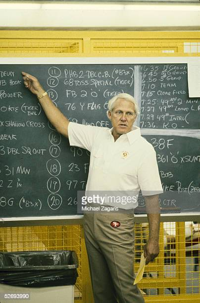 Head coach Bill Walsh of the San Francisco 49ers gives instructions on the chalkboard prior to the game against the Minnesota Vikings at the Hubert H...