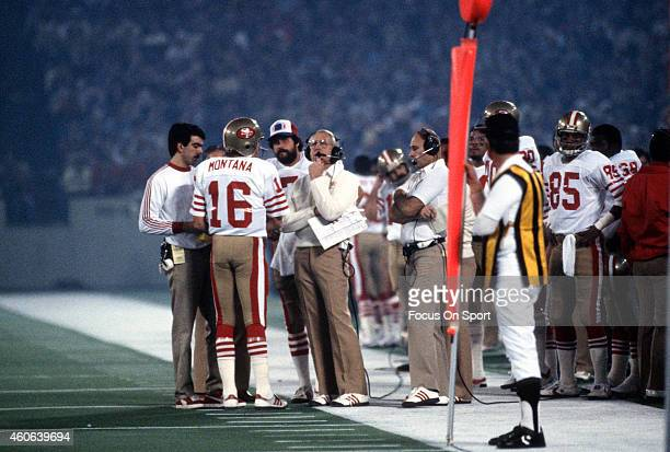 Head Coach Bill Walsh of the San Francisco 49ers talks with his quarterback Joe Montana during a timeout against the Cincinnati Bengals in Super Bowl...