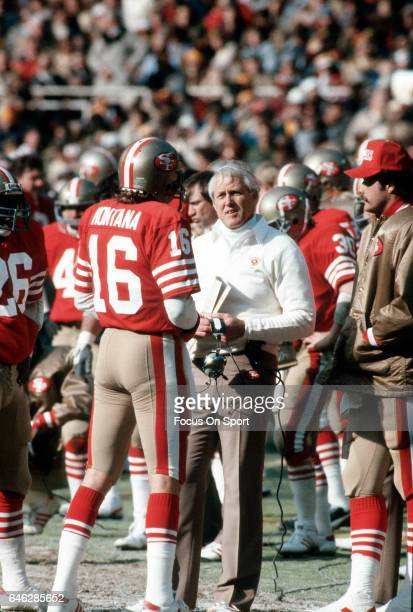 Head coach Bill Walsh of the San Francisco 49ers talks with quarterback Joe Montana on the sidelines during an NFL Football game at Candlestick Park...
