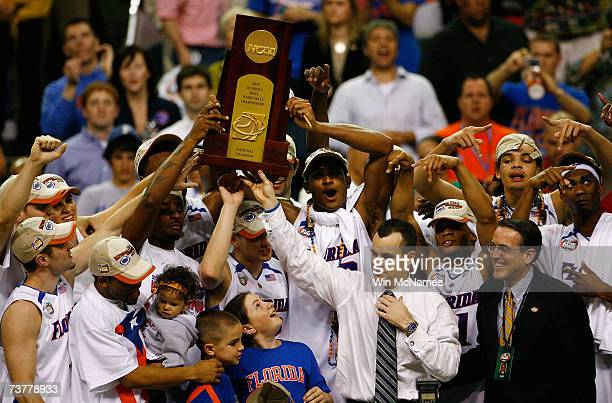 Head coach Billy Donovan and his Florida Gators celebrate with the trophy after defeating the Ohio State Buckeyes during the NCAA Men's Basketball...
