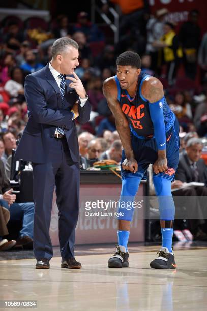 Head Coach Billy Donovan and Paul George of the Oklahoma City Thunder talk during the game against the Cleveland Cavaliers on November 7 2018 at...