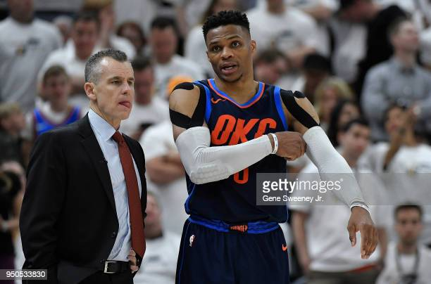 Head coach Billy Donovan and Russell Westbrook of the Oklahoma City Thunder talk during Game Four of Round One of the 2018 NBA Playoffs against the...