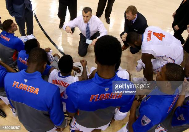 Head coach Billy Donovan of the Florida Gators talks with his team as they huddle while taking on the Pittsburgh Panthers during the third round of...
