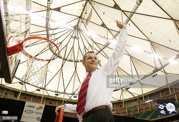 Head coach Billy Donovan of the Florida Gators waves to the crowd as he cuts down the net after defeating the Kentucky Wildcats in the SEC Men's...